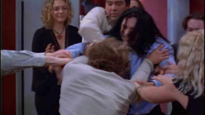 la rissa fra Johnny (Wiseau) e Mark (Sestero) in The Room